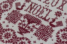 "Joyeux Noël - Cross Stitch sampler (detail). This pattern was stitched  with ""Tudor Red"" embroidery wool on 32ct ""Flax"" linen."