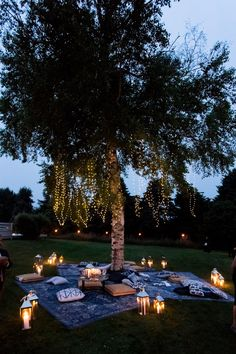 a lounge area, where blue throw pillows and string lights created a relaxed, Moroccan-inspired feel Outdoor Bridal Showers, Summer Bridal Showers, Cozy Wedding, Wedding Lounge, Hamptons Wedding, The Hamptons, Lounge Party, Reception Seating, Outdoor Events