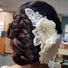 """""""How fun is that hair piece though! #bride #bridalhair #updo #lowbun #hairups #hairart #hairpin #hairstylist #highlights #glossycurls #weddinghair…"""""""