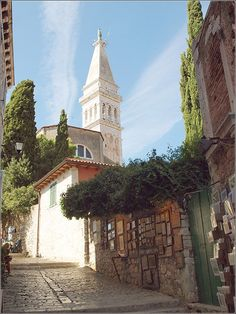 One of the streets in old town of Rovinj, Croatia with a spire of St. Euphemia church Copyright: Natalia Barsova