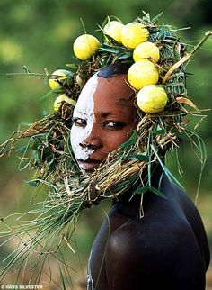 Yet far from the catwalks of New York, London or Paris, these looks are the sole creation of the Surma and Mursi tribes of East Africa's Omo Valley.    Inspired by the wild trees, exotic flowers and lush vegetation of the area bordering Ethiopia, Kenya and Sudan, these tribal people have created looks that put the most outlandish creations of Western catwalk couturiers to shame.