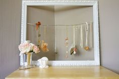 Way to hang necklaces using an old frame