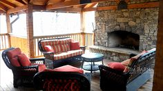 Outdoor living: The extra large porch and outside fireplace makes this American log home by Jim Barna Log & Timber Homes unique, a perfect place for family gatherings. To receive more pictures or floor-plans or to learn more about our homes, please visit www.jimbarna-loghomes.com or email at zoltan@jimbarna.loghomes.com