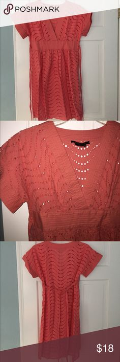 BCBGMaxAzria V-neck eyelet dress or coverup Peach colored eyelet cotton dress with short sleeves and tie back waist. Gathers at front waist, straight back. Wear over a slip dress or as a beach coverup! Cute! BCBGMaxAzria Dresses