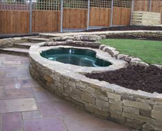 Water feature, dry stone walling incorporating raised pond