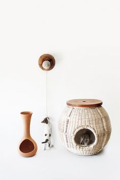 cluc - laia fusté cusóThis collection includes three objects: a nightstand-house, a feeder to share human leftovers and a toy. Each one of them has been studied with three different materials (wicker, ceramics and olive wood) and with three craftsmen from Alt Empordà (Catalonia): a basket maker, a potter and a wood turner respectively.