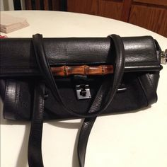AUTHENTIC GUCCI TOM FORD Bullet PURSE Classic design with monogrammed canvass & bamboo detail. Trimmed in leather. It's elongated & round with flat leather handles. Has stud details & protective studs underneath bag. Push lock closure zip pocket inside. Comes with dust bag. Excellent condition. Additional pics posted Gucci Bags Satchels