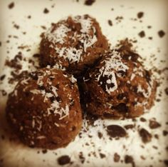"""Heavenly Cocoa Bites shared by alexabs_livinglife. 2 scoops chocolate Perfect Fit Protein, 1/4 tsp sea salt, 1/2 cup unsweetened coconut flakes, 2 tsp cacao powder, 1/3 cup unsweetened almond milk, 2 tbsp coconut oil, 1/4 cup cacao nibs. Mix dry and wet ingredients separately. Combine wet mixture into dry, then fold in cacao nibs. Roll into 1"""" balls and refrigerate for 20 minutes. Serving size is 2."""