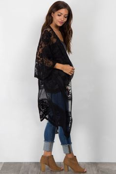 Solid lace mesh long maternity kimono. Scalloped trim. Open front. Short sleeves. This style was created to be worn before, during, and after pregnancy.