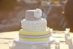 My wedding cake!! Inspired by another cake found here on Pinterest. <3 Yellow and grey with white ruffles. Gorgeous!
