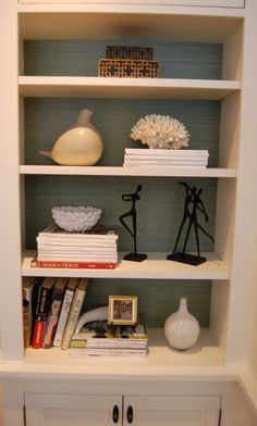grasscloth in bookshelves, adds another layer
