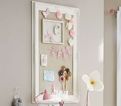 """Baroque Utility Pinboard #pbkids; $299 (2/2015). **OVERPRICED!** It's MDF!  A lavish floral frame transforms a practical pinboard into grand wall art. 48"""" wide x 32"""" high x 2.5"""" thick Expertly crafted of MDF. Linen fabric is sewn onto corkboard. Simply White finish. Use to pin notes, photos, artwork and more. D-ring mount; mounting hardware not included. Can be hung vertically or horizontally."""