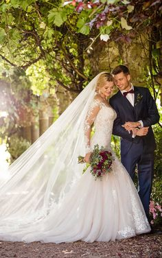 Martha Stewart Weddings - A modern update on the classic lace wedding dress, this wedding gown with off-the-shoulder sleeves from Essense of Australia is a must for the fashion-forward bride.