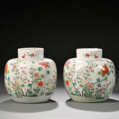 Pair of Famille Rose Covered Ginger Jars, China, 19th century, decorated with various flowering plants including tree peonies and chrysanthemums, ht. 8 1/2 in.