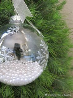 DIY Snowflake ornament - Martha Stewart Multi-Surface Craft Paint in Pearl, snowflake stencil, add pearls inside ornament