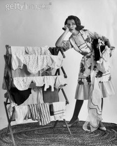 My Mom's life...and many others who had to  scrub, wring and dry clothing outdoors on a line or drape them on these clothes dryers.