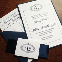 Navy blue and white wedding invitation with satin ribbon belly band.