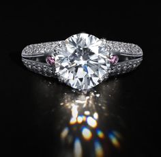 A diamond single-stone ring, by Hardy Brothers  The brilliant-cut diamond, weighing 5.07 carats, in a double four-claw setting to bifurcated similarly-cut diamond shoulders with diamond highlights of pink tint, tinted diamonds untested for natural colour, maker's pouch,