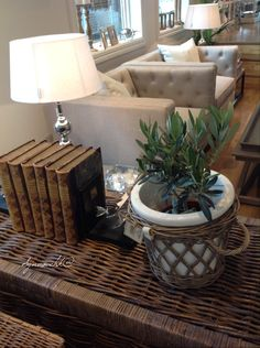RIVIERA MAISON mixed with antique books and olive...I love it. At LENE INTERIØR, STAVANGER