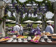 A breakfast station featuring delicious pastries and colorful seasonal fruit greets the guests as they walk into the reception.
