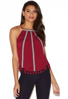 Be the life of the party in the Sleeveless Embroidered Top. Trendy tassel accents along the hem, bold embroidery and a back keyhole come together for a festive look.