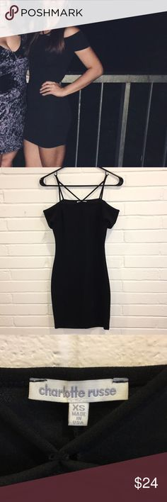 Charlotte Russe - Black off the shoulder bodycon Worn once to a formal (perfect condition) Charlotte Russe Black off the shoulder bodycon mini dress with sexy front strappy detail - straps add for great support that keeps off the shoulder dress from falling down/moving around!  Similar styling: Bebe, tobi Charlotte Russe Dresses Mini