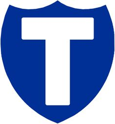 Toronto Blueshirts Primary Logo (1913) - A white T on a blue shield, seen on Blueshirts trainer and coaches jackets