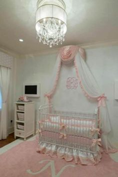our joy crib looks pleasantly sweet in this nursery designed by Michelle Henry of Little Blue Bunny