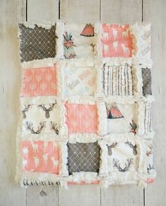 These woodland prints in coral and brown are so beautiful and are the perfect addition to a baby girl's nursery, or even just for a fun stroller blanket! This quilt is done in such pretty, modern colors with beautiful florals, arrows, and deer prints. The back of this quilt will be done in mink