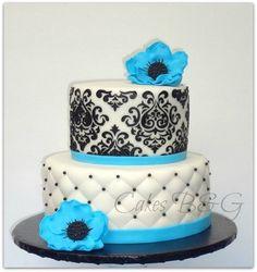 Blue, black and white birthday cake