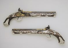 Pair of flintlock pistols, 1800–1801  Samuel Brunn (English, 1795–1819); Michael Barnett (English, 1763–1817)  Steel, wood, silver, gold. These pistols epitomize the opulence of English decorative arts produced during the reign of the Francophile prince regent, for whom they were reputedly made. (www.metmuseum.org).