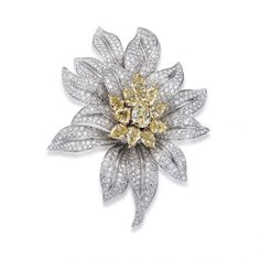 Blossom collection Jonquille brooch, elegant petals set with brilliant cut diamonds highlighted by an important pistil made of fancy-yellow pear-shape diamonds by Picchiotti