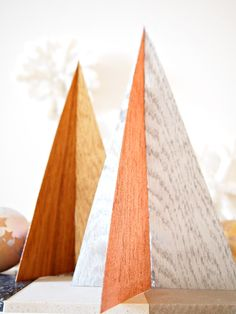 Wood veneer trees, painted with copper, silver and gold.