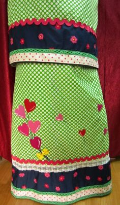 Pretty summer wear rida for Rs.1890 only!!  Lime green polka dotted cotton rida designed using midnight blue cotton floral panel with trims, lace and appliques. Heart shaped girly pink colored applique balloons enhance the perfect bubbly look of this rida.