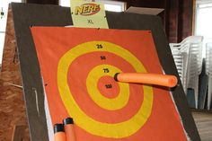 Nerf XL. A giant Target made out of felt. Pool noodles from $1 store. I cut them in half, put self sticking Velcro on the end and wrapped tip in black electrical tape. Looks like a giant nerf dart. Made enough to be party favors.