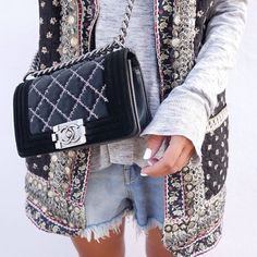 This Chanel bag takes this embellished vest to the next level!