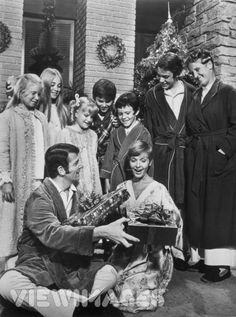 The Brady Bunch on Christmas morning... carol got her voice back. I still cry when I watch this episode, when cindy tells mike that santa clause is better than a doctor.