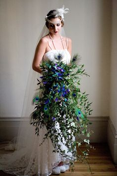 We are loving this Gatsby themed, over the top wedding bouquet, with peacock feathers and ivory.  Downton Abbey 1920's style wedding bouquet. Wedding style bouquet. Great Gatsby wedding style.