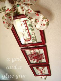 Dollar store frames and snowflake ornament, spray painted, and vinyl letters with ribbon. Possibly hang on door instead of wreath?