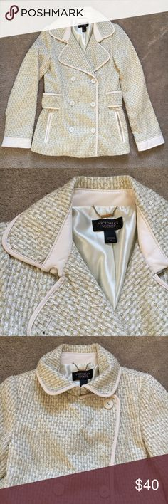 """VS Cream & Gold Dress Coat NWOT. Very nice dress coat! Cream with metallic gold running through. I'm not sure if it's trimmed with a cream faux or genuine leather. Cream satin lining. Front pockets. 27"""" long. Add to a bundle or Make an offer! 🖤 Victoria's Secret Jackets & Coats Trench Coats"""
