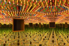 Yayoi Kusama: Infinity Mirrored Room – Love Forever, 1966/1994, at the Hirshhorn museum and sculpture garden.   Wood, mirrors, metal, and lightbulbs.  Photo: Cathy Carver