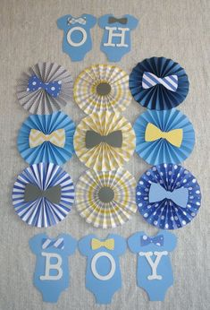 ONESIE WITH BOW TIE THEME DECOR FOR BABY SHOWER BLUE, GRAY AND YELLOW PAPER ROSETTES These rosettes will be perfect for a baby shower or even