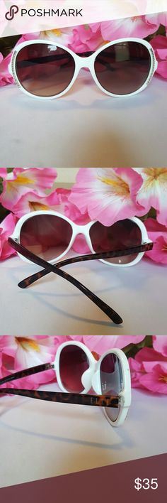 Elle White Oversized Sunglasses Oversized white rims with tortoise shell arms. 138mm Elle Accessories Sunglasses