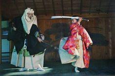 "Stéphane Passet<br>  Japan, c.1912<br>  The monk Benkei crosses swords with child Ushiwaka on Kyoto's Gojo Bridge in a scene from the Noh theatre classic ""Hashi Benkei."""