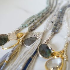 """Beautiful necklaces by Dorrit and Millie. The """"bails are macramed metallic thread or cord."""