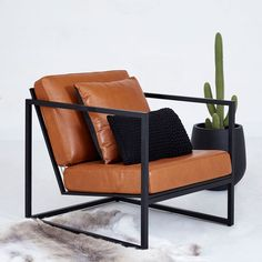 Black Metal Frame and Tan Leather Armchair - Designer Accent Chairs Tan Leather Armchair, Black Armchair, Brown Leather Chairs, Leather Accent Chairs, White Leather, Leather Cushions, Modern Armchair, Steel Furniture, Leather Furniture