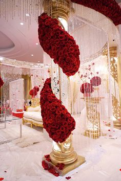 crystal + rose mandap, luxe mandap, red roses on mandap.... would be pretty on columns with maybe.... light pink or ivory roses.                                                                                                                                                     More
