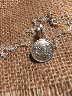 On a sterling silver twisted chain. Hangs a 3 cm Long pendent , there is a large twisted diamond cut link,on this link is a silver three pence piece, year . Handmade Silver Jewellery, Silver Jewelry, Diamond Cuts, My Etsy Shop, Buy And Sell, Sterling Silver, Chain, Pendant, Bracelets