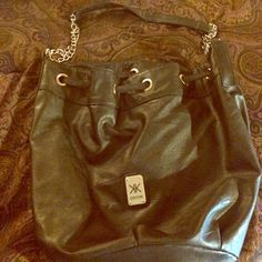 Kardashian Kollection Crossbody Bag Great condition. Very spacious. Tassel on the back and button inside. Kardashian Kollection Bags Crossbody Bags