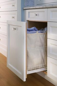 Eliminate the need for a laundry basket in the room with this space-saving, built-in hamper.